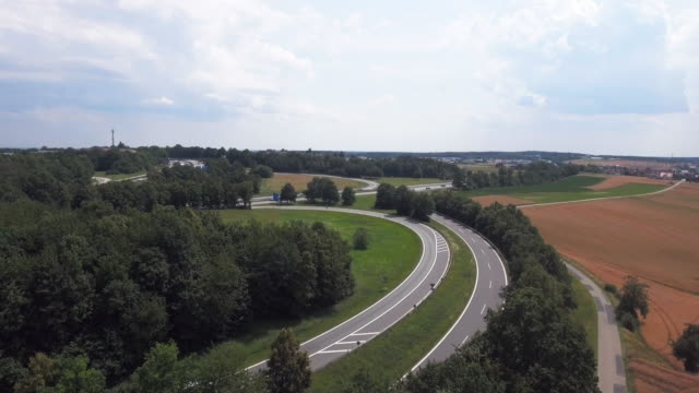 AERIAL Traffic On Cloverleaf Interchange Offramp (4K/UHD) Flyover shot made from drone operating over cropland. 4K/Ultra High Definition goodbye single word stock videos & royalty-free footage
