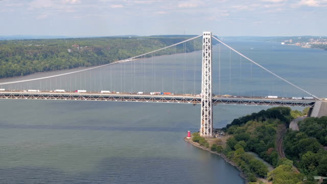 AERIAL: Traffic on double-decked George Washington suspension bridge over river video