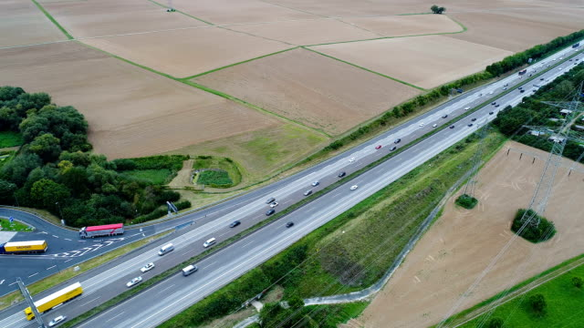 Traffic on highway and rest area Traffic on highway and rest area - aerial view autobahn stock videos & royalty-free footage
