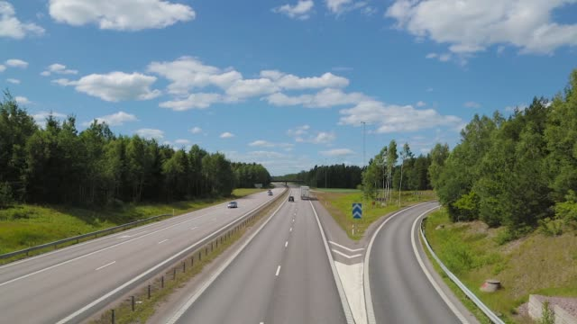 Traffic on highway at day - high angle view Autobahn Denmark. Traffic on highway at day - high angle view. High angle view of cars driving on a european highway at sunny day. Car driving on the highway. autobahn stock videos & royalty-free footage