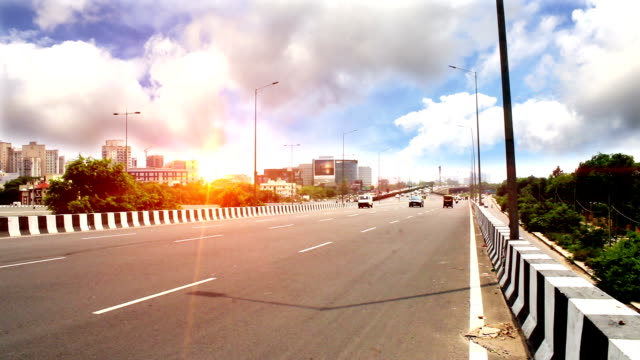 Traffic on highway under the beautiful cloudscape video