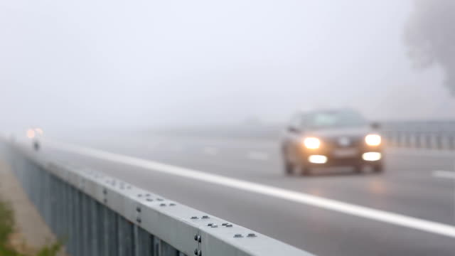 traffic on highway with fog - autobahn video stock e b–roll