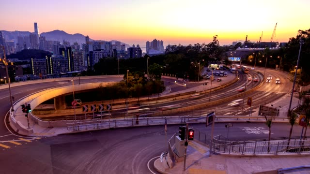 Traffic on multiple lane highway with motion blur in Hong Kong at dusk - Time lapse video