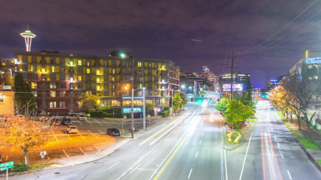 traffic on road,modern office buildings,cityscape and skyline at night in seattle. timelapse 4k video