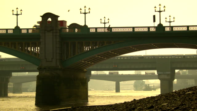 Traffic on the bridges of London, pan towards the city video