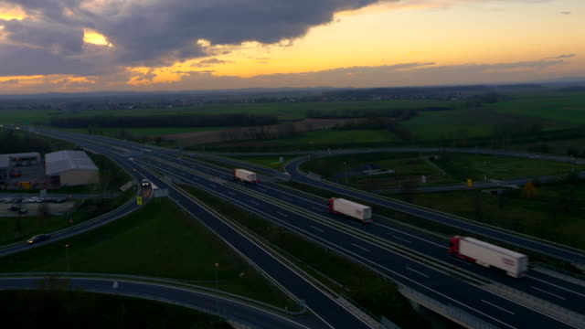 AERIAL Traffic On The Highway Intersections At Dusk video