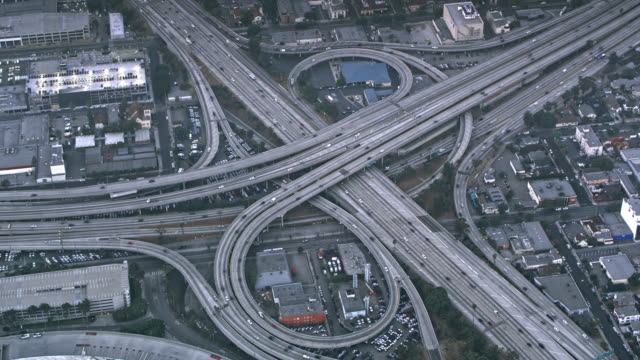 AERIAL Traffic on the massive highway intersection in Los Angeles, CA