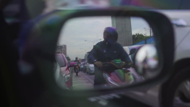 Traffic that looks through the car side mirror Traffic that looks through the car side mirror rear view mirror stock videos & royalty-free footage