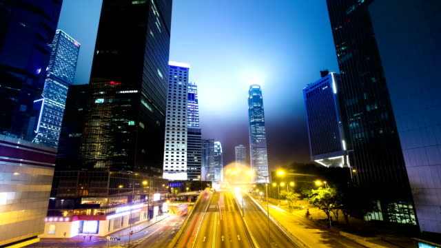stockvideo's en b-roll-footage met traffic through modern city at night,time lapse - hongkong