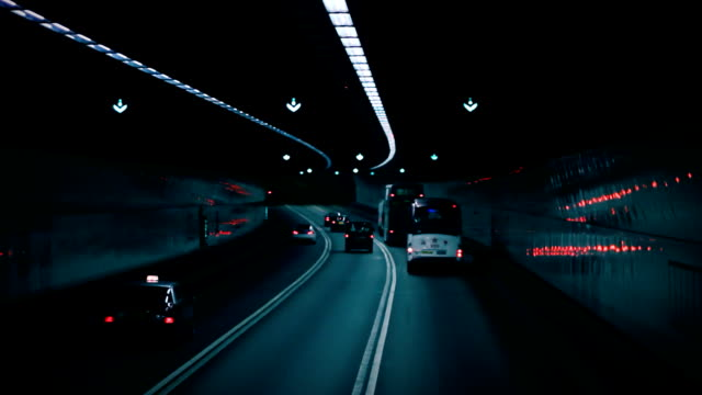 Traffic Tunnel Tracking shot of traffic going through a tunnel. goodbye single word stock videos & royalty-free footage