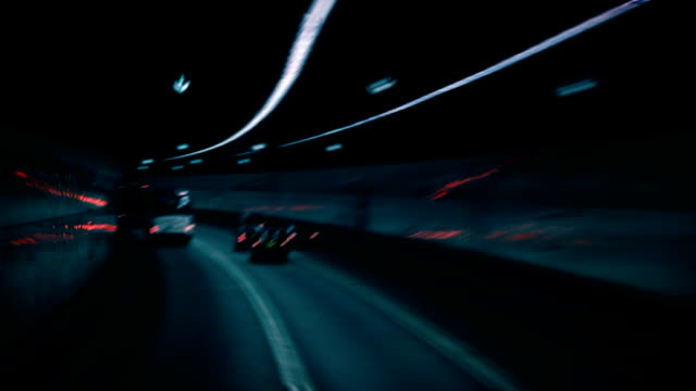 Traffic Tunnel Tracking shot of traffic going through a tunnel at high speed. chasing stock videos & royalty-free footage