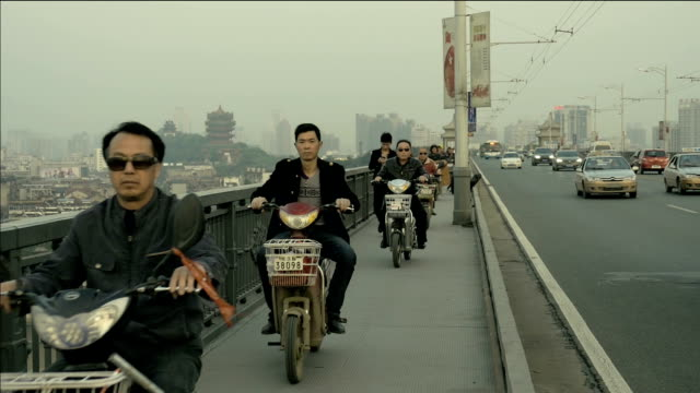 Traffic with motorbikes going on pedestrian area in China video