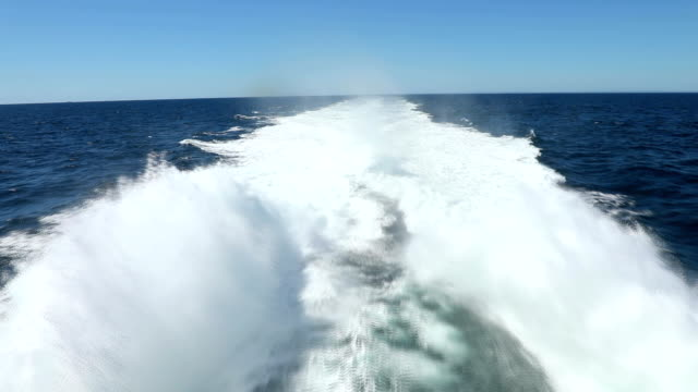 Trail print on water surface behind of speed boat Trail print on water surface behind of speed boat or Fast catamaran {{asset.href}} stock videos & royalty-free footage