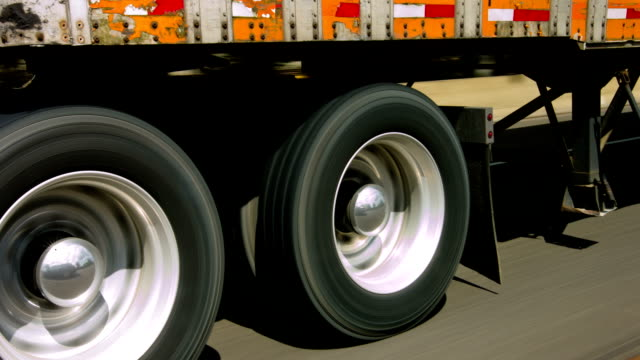 Trailer Side shot of wheels of truck trailer on freeway tires stock videos & royalty-free footage