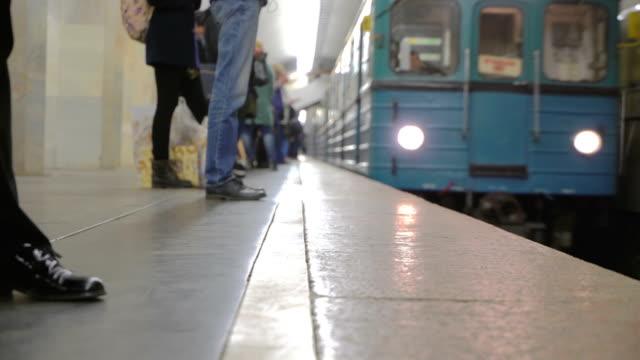 train arrived on platform. doors opened and passengers leave and enter car. concept city transport - wchodzić na pokład filmów i materiałów b-roll