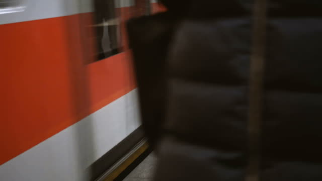 train arriving at an underground station and people waiting - milan railway video stock e b–roll