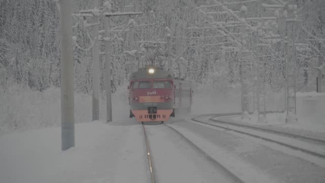 Train arriving at Siberian station to pick up skiers Winter forest scene siberia stock videos & royalty-free footage