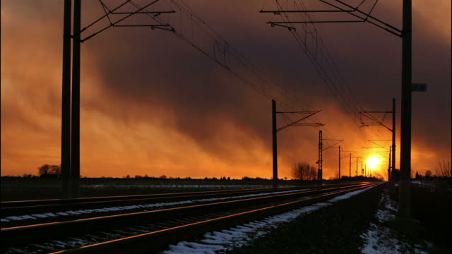 Train cargo in railroad at sunset - time lapse video