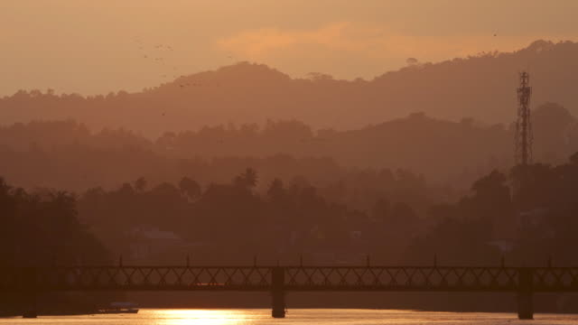Train Crossing a Bridge at Sunset: Sri Lanka