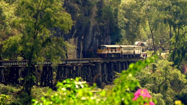 Train crossing Krasae Viaduct in Kanchanaburi, Thailand video