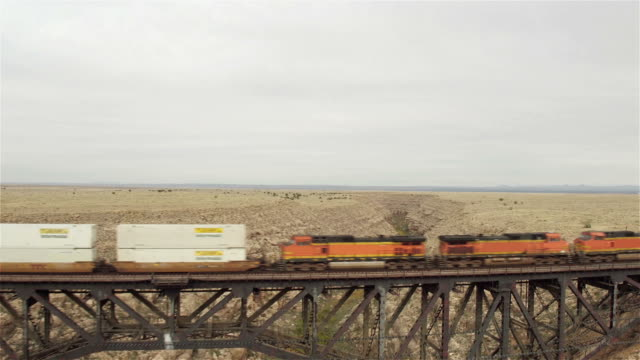 AERIAL: Train crossing steel arch railroad bridge across the Canyon Diablo video