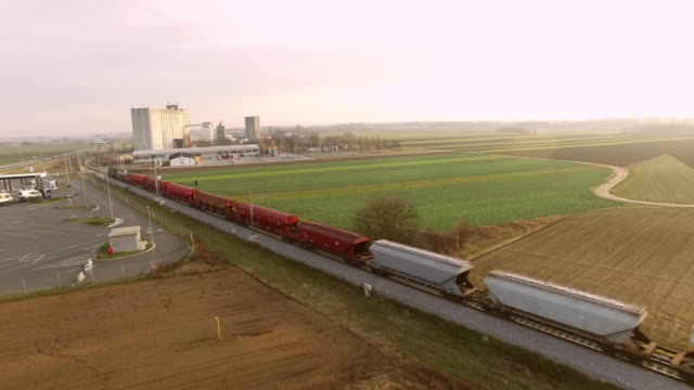 AERIAL Train heading along industrial area video