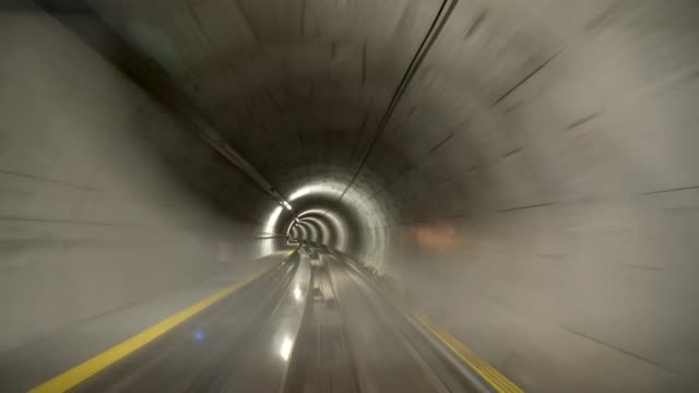 4k train in the tunnel with motion blur at the airport - szwajcaria filmów i materiałów b-roll