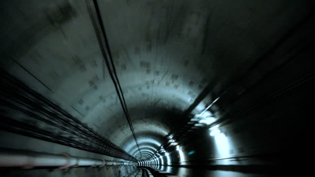Train intersecting through the tunnel