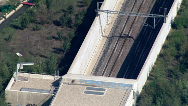 Train into tunnel - Aerial View - Provence-Alpes-Côte d'Azur, Vaucluse, Arrondissement d'Avignon, France video