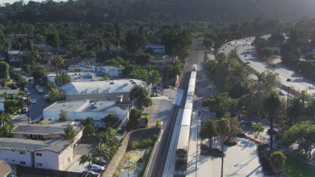 Train Leaving Santa Barbara - Drone Shot video