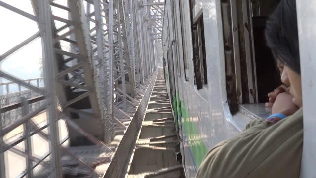 train pass Irrawaddy River bridge