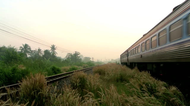 Train Running over Rural Railway at Sunrise or in the morning video