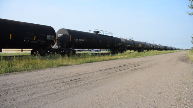 Video train tankers passing on tracks