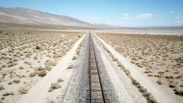 Train Tracks Extending Into Distant Desert Under Sun California, Desert - Barren, Train Tracks tramway videos stock videos & royalty-free footage