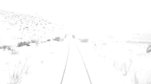 Train travel in railway tunnel in winter