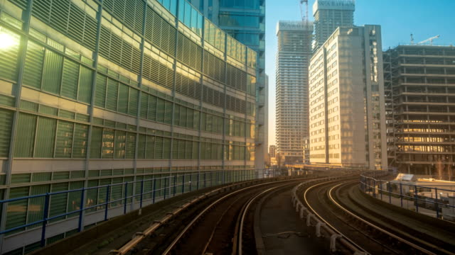 Train Trip Hyperlapse Through Central London, England, UK A frantic POV hyperlapse of a train journey along the Canary Wharf Docklands District of London, England, UK on a sunny day railroad track stock videos & royalty-free footage