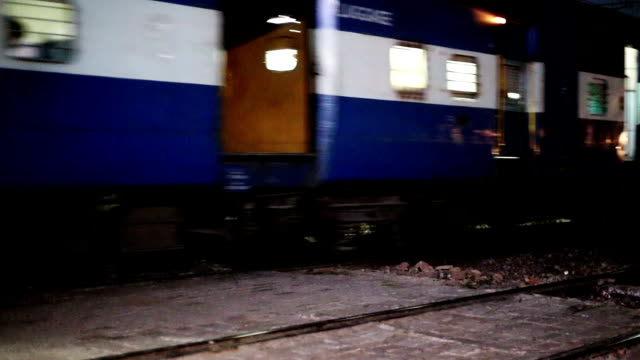 Train High speed train running on railroad track at night located in Haryana, India. intercity stock videos & royalty-free footage