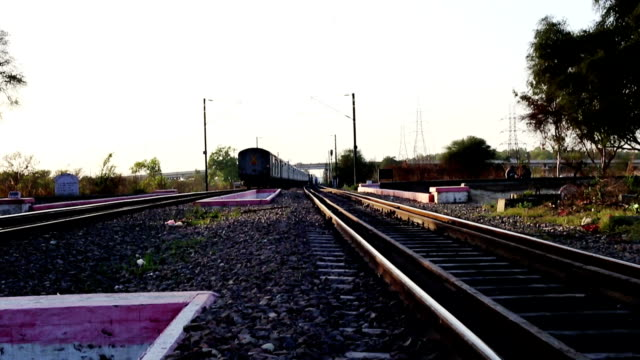 Train High speed train running on railroad track located in Haryana, India. intercity stock videos & royalty-free footage
