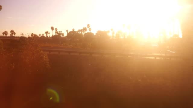 train window view on a california highway in 4k slow motion 60fps - passare davanti video stock e b–roll