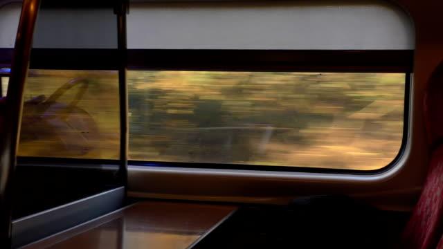 train window view speed and houses - wagon kolejowy filmów i materiałów b-roll