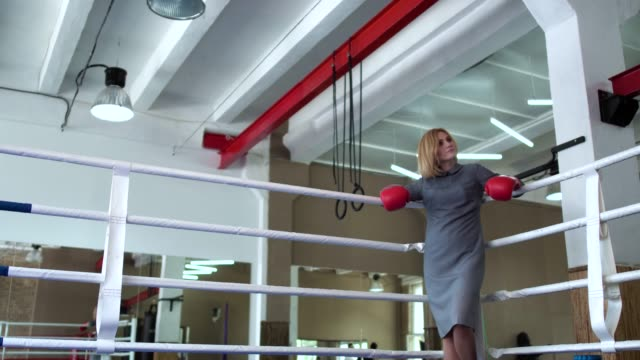 Trainer greeting woman at boxing ring video