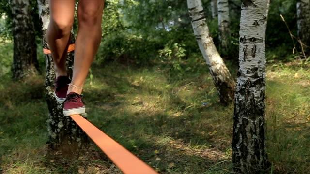 training acrobatics in nature,close up - balance video stock e b–roll