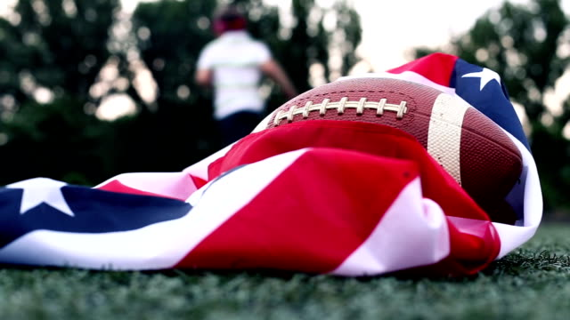 Training American flag and a rugby ball video