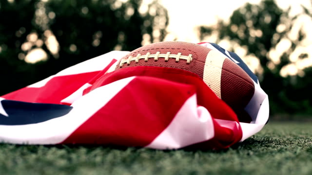 Training with an American flag and a rugby ball video