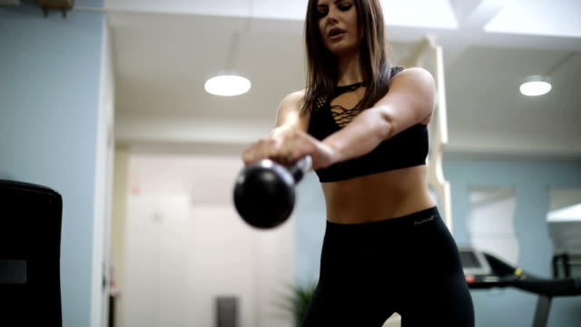 Training with kettlebell in gym video