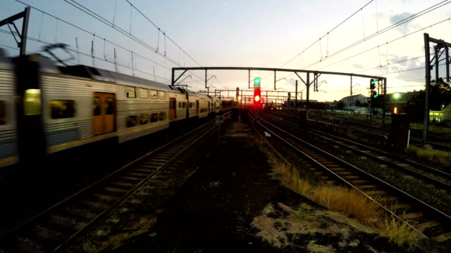 Trains at busy train station peak hour video