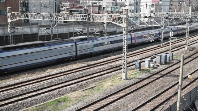 trains passing on rails, in seoul city ,south korea. - intercity filmów i materiałów b-roll