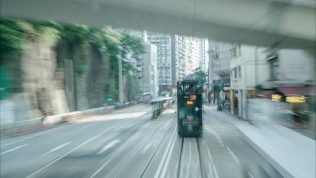 Tram on a hong kong street (tram view). video