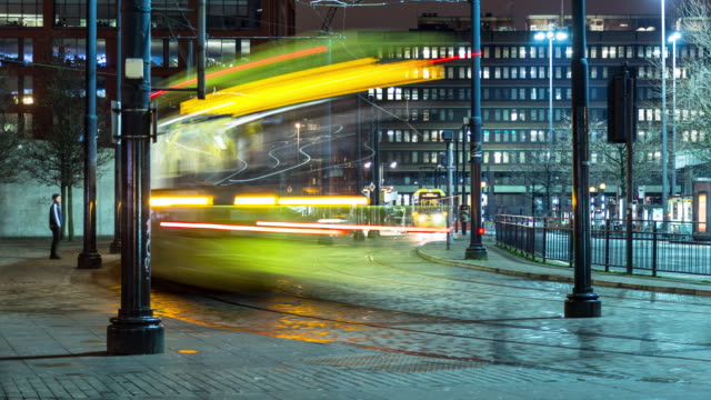 trams in piccadilly gardens, manchester - manchester inghilterra video stock e b–roll