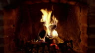 istock 8K Tranquil, crackling fire and ash in brick fireplace, real time with audio 873971832